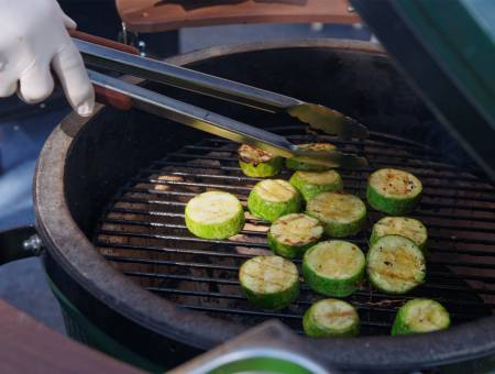 Zucchini being fried on grill