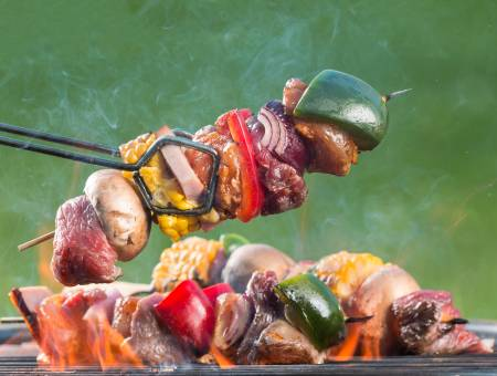 skewer on barbecue grill with fire