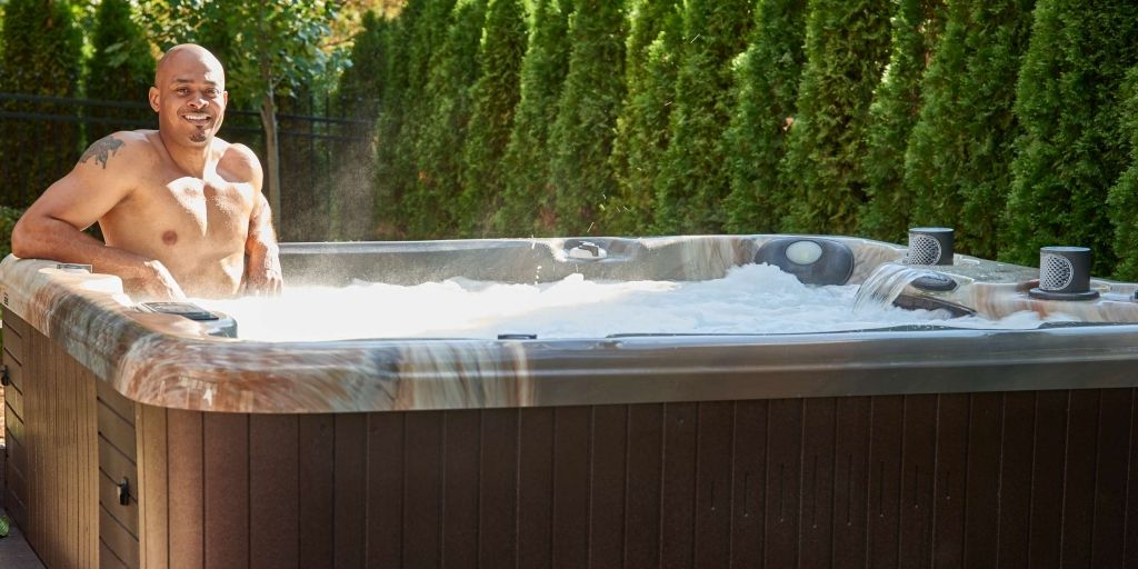 Man in Steaming Hot Tub