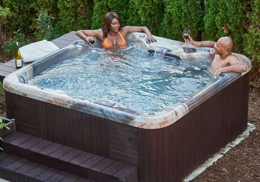 Couple In Hot Tub with Wine 2