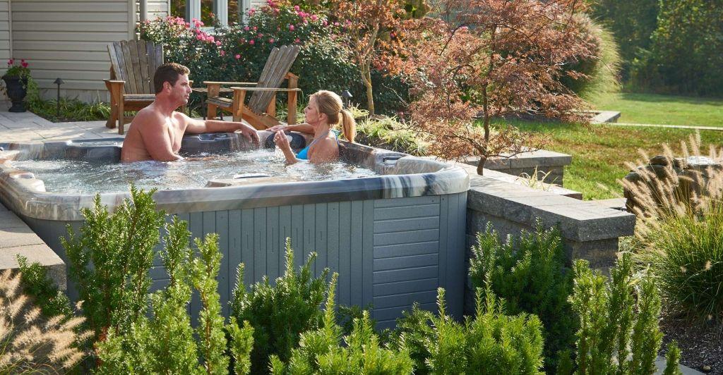 Couple in Hot Tub Beautiful Backyard 3