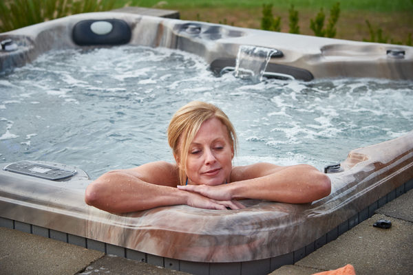 Woman Relaxing Alone in Hot Tub