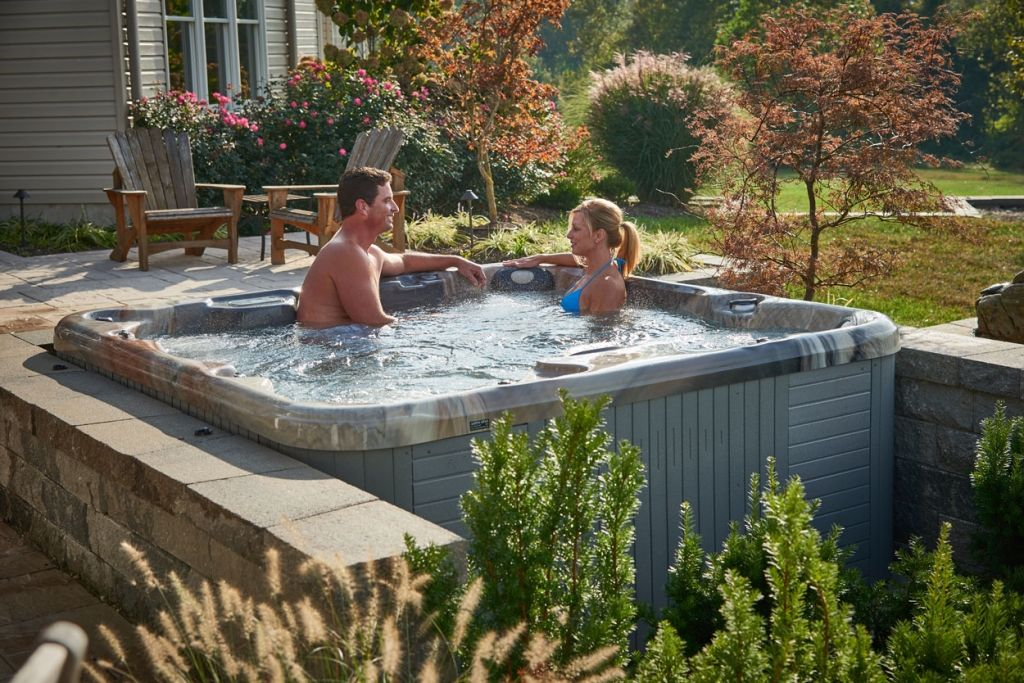 Couple in Hot Tub Beautiful Backyard