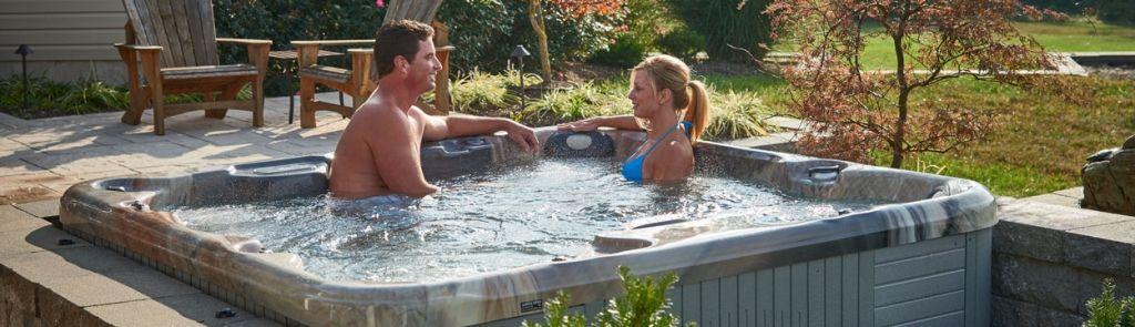 Couple in Hot Tub Beautiful Backyard 2