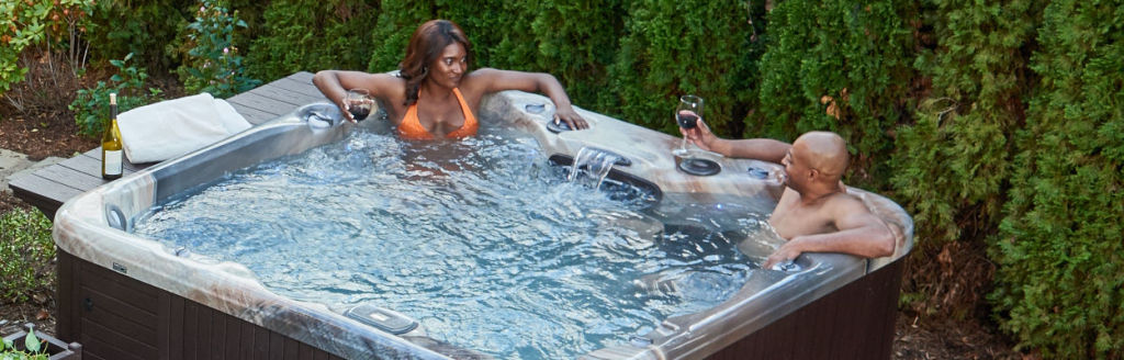 Couple relaxing with wine in hot tub