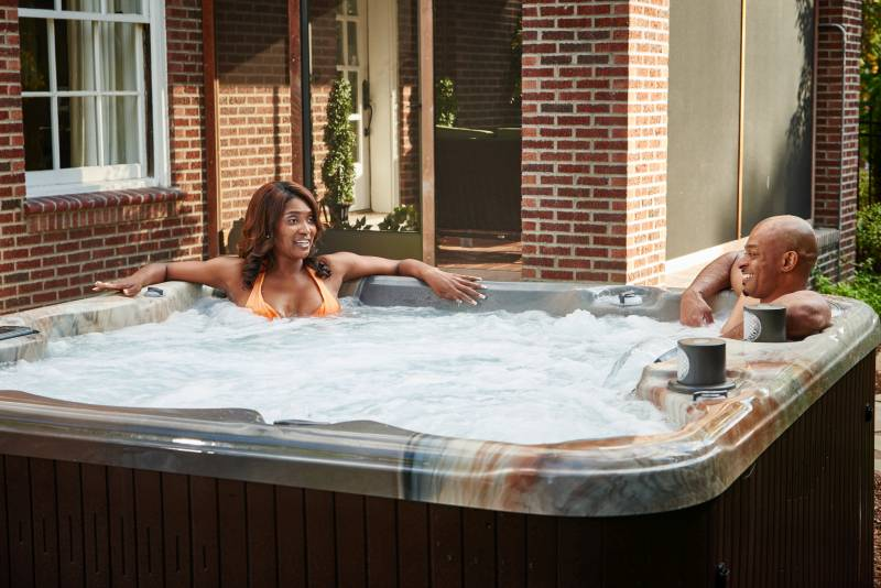 Two happy people in a hot tub