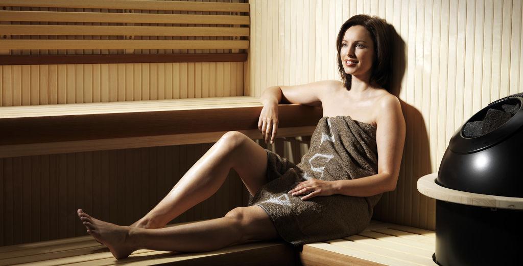 person enjoying using a sauna