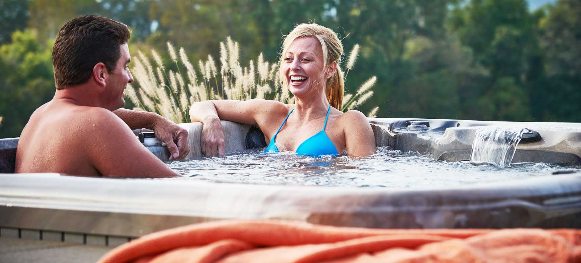 two people soaking in a hot tub